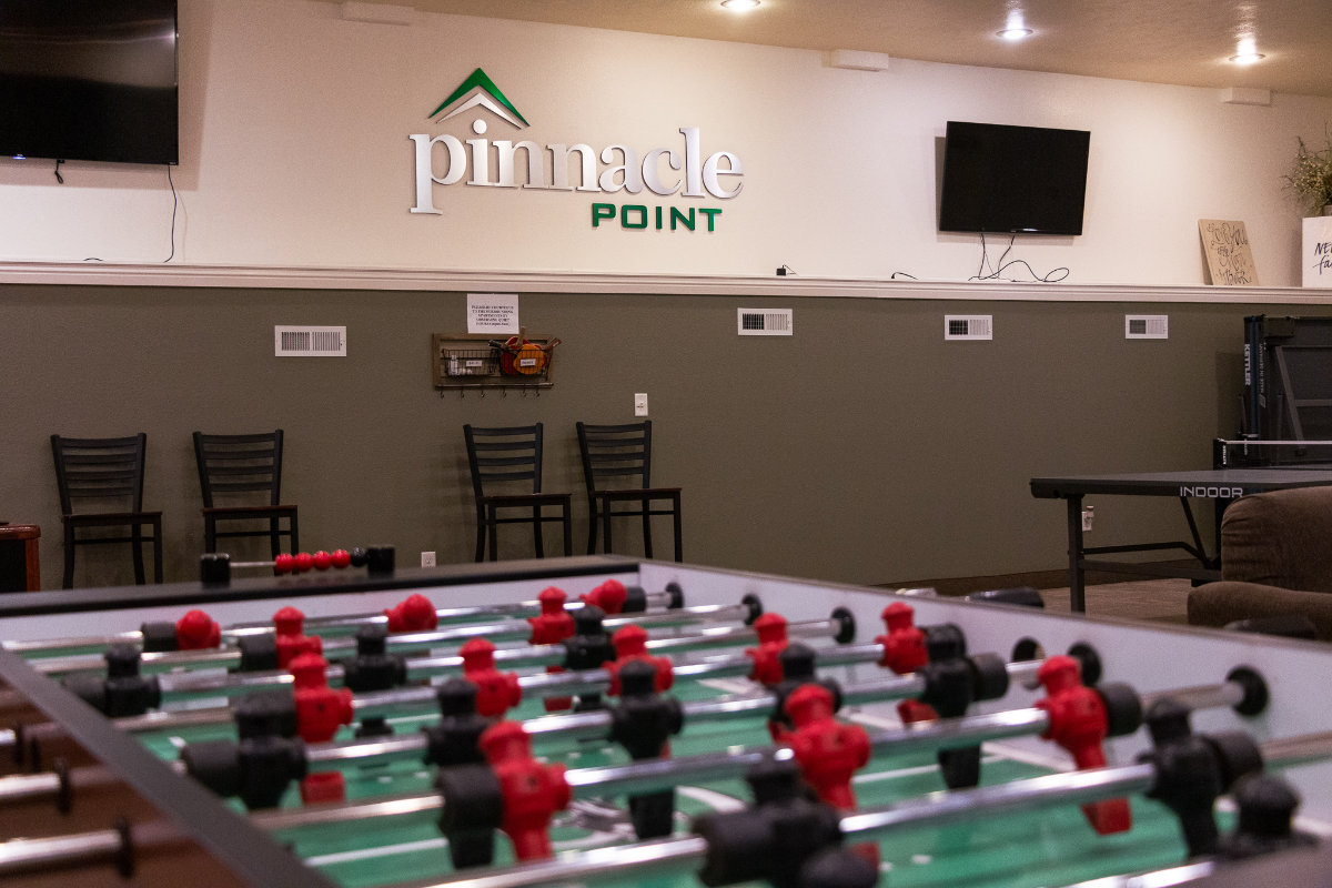 Lobby Game Room With Pool, Ping Pong and Foosball Tables